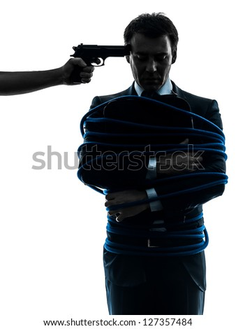 captive hostage business man  in silhouette studio isolated on white background