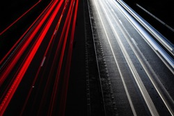 Capture of light trails from cars seen on the dual carriageway below.  Headlights and tail lights provide the white and red contrast.