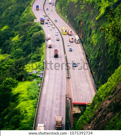 Captured this picture of the Mumbai-pune expressway from Khandala ghat during the monsoon of 2017. The expressway is one of the busiest roads in India. - Shutterstock ID 1075392734