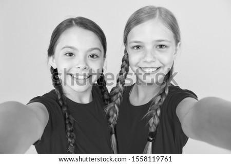 Capturing moments. Child girls taking photo. Children kids happy faces. Video call concept. Blog online. Girls taking photo. Selfie for social networks or blog. Blogging modern trend. Personal blog.