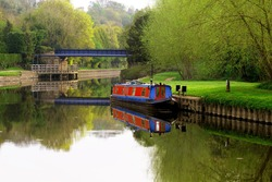 Capturing perfect symmetrical patterns of a blue bridge and barge, on Sprotbrough Flash, on Easter Sunday.