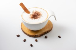 Capuccino coffee in vintage style cup and coffee beans  in coffee break. Capuccino coffee and cinnamon .