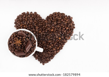 Capuccino cup filled with coffee beans