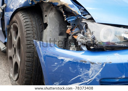 car accident, damaged vehicle after crash staying on the street