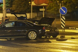car accident in the night city. two vehicles crashed in a metropolitan street