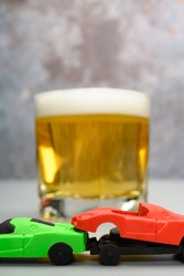 car accident with cup of beer at background concept of drunk driving no logo no trademark