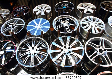 Car alloy wheel in store. Closeup Useful as background for design-works.