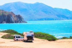 Car and Camper at Capo Pecora at the Mediterranean sea, Sardinia, Italy