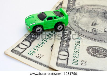 Car and money over white background