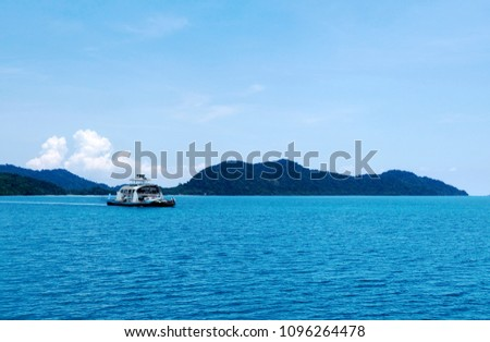 Car and passenger boat ferry on the sea. Ferry boat taking cars and passengers crossing between land and Chang island in Trat, Thailand.