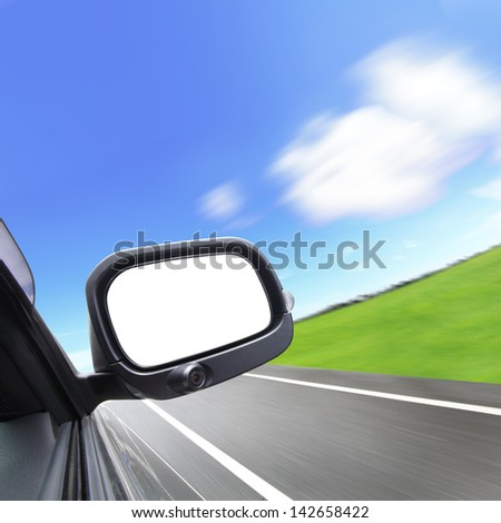 car and rear view mirror on the road