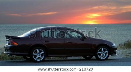 Car at the beach at sunset...