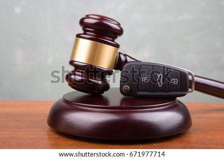 Car auction concept - gavel and car key on the wooden desk