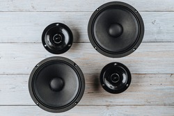 Car audio, car speakers on a white wooden background.
