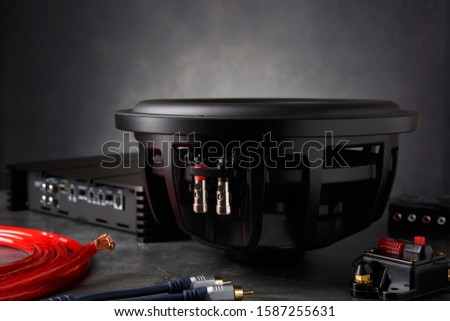 car audio, car speakers, subwoofer and accessories for tuning. Dark background. Сток-фото ©