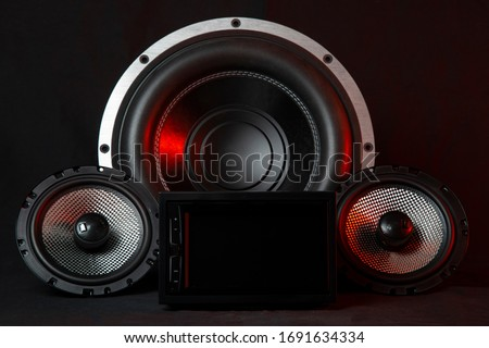 Car audio system on a black background.Subwoofer. Сток-фото ©