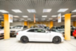 Car auto dealership themed blur background with bokeh effect