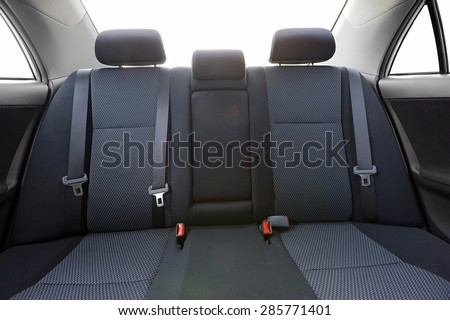 Car backseats with intentional light flare from the burnt out background