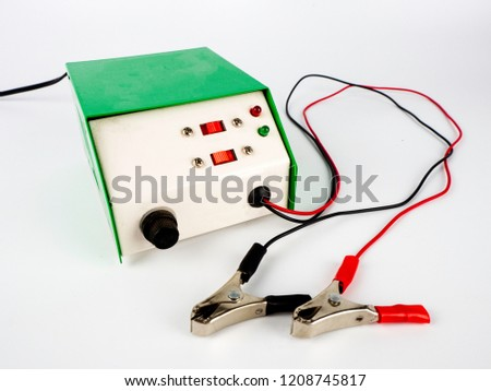 Car battery charger, AC/DC converter, rectifier on white background. #1208745817