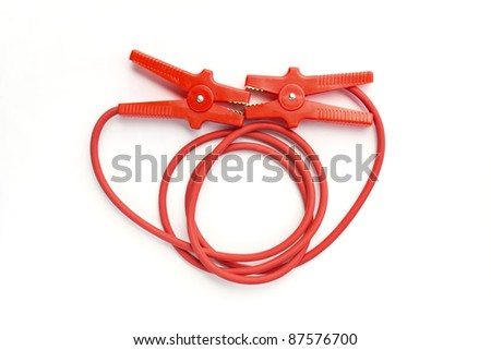 Car battery jumper cables over white background
