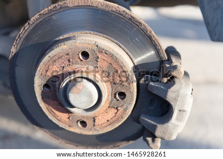 Car brakes. Work in tire shop. Brake disc after removing the wheel. #1465928261