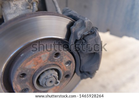 Car brakes. Work in tire shop. Brake disc after removing the wheel. #1465928264