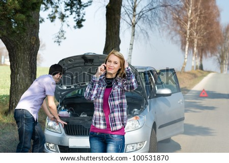Car breakdown couple calling for road assistance man look engine
