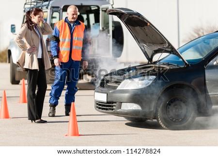 Car breakdown woman get help road assistance man smoking engine