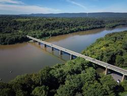 Car bridge going over the Potomac River on a sunny day near Brunswick Maryland
