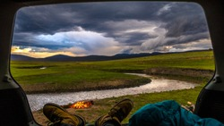 Car Camping View by S River while Storms Gather
