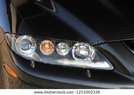 Car. Car headlights. Luxury Headlights #1251002338
