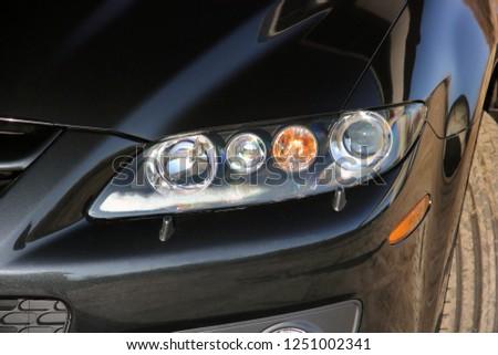 Car. Car headlights. Luxury Headlights #1251002341