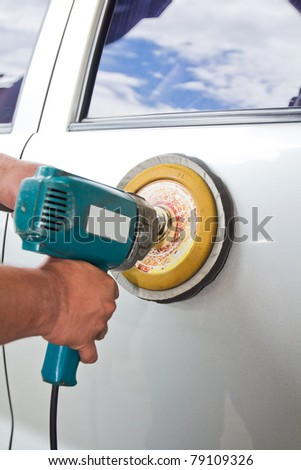 Car care with power buffer machine . CAR CARE images closeup Useful as background for design-works.