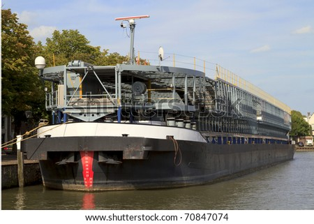 Car carrier used for transporting cars on the river docked in a harbor in Dordrecht