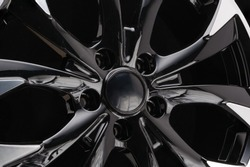 car cast aluminum alloy wheels, black silver with polished front, very beautiful and modern, fashion. Close-up on dark background, elements, spokes.