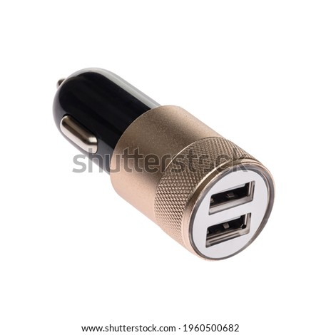 Car charger for mobile phone or smartphone. Connector for a cable for a USB port. Plugs into the car's cigarette lighter. Black and gold Photo stock ©