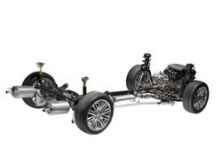 Car chassis with engine. Image of car chassis with engine isolated on white.