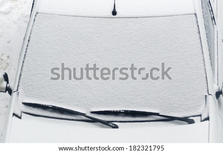 car cover after snowfall. snow surface