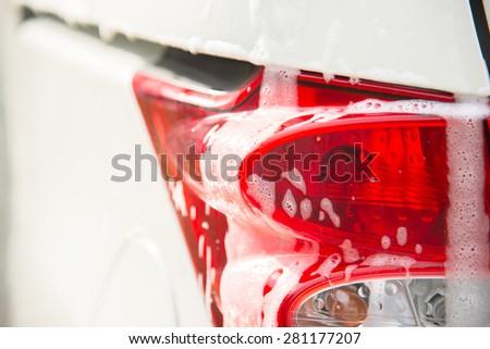 Car covered by foam. Car wash.