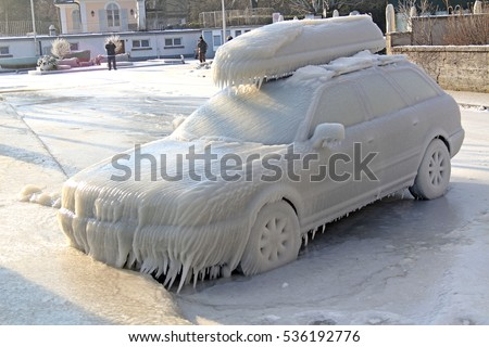 Car covered by ice at the Versoix promenade, Lake Geneva, Western Switzerland