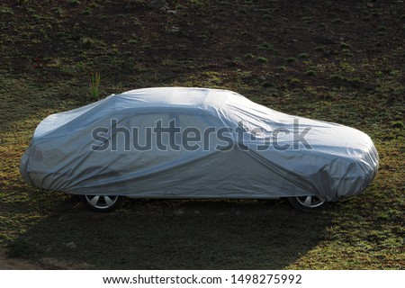 Car covered with a protective cover. #1498275992