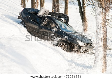 car crash accident at snow road in winter