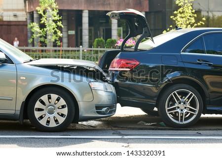 car crash accident on street. damaged automobiles #1433320391