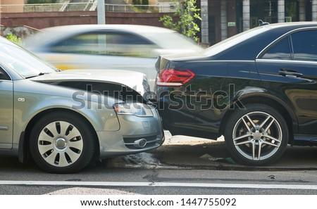 car crash accident on street. damaged automobiles #1447755092