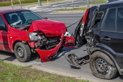Car crash accident on street, damaged automobiles after collision in city