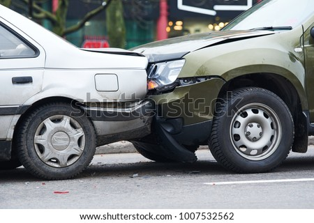car crash accident on street, damaged automobiles after collision in city #1007532562