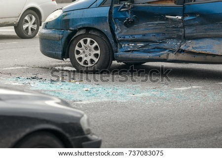 car crash accident on street, damaged automobiles after collision in city #737083075