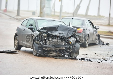 car crash accident on street, damaged automobiles after collision in city #779605807