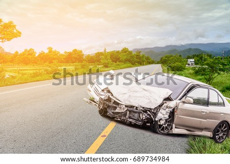 car crash accident on street, damaged automobiles after collision in suburban, countryside on bad weather #689734984