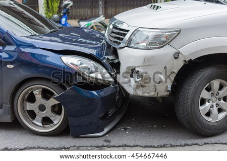 Car crash from car accident on the road in a city between saloon versus pickup wait insurance. #454667446